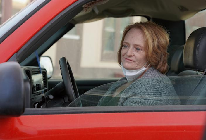 Ivy Charles stares down Main Street in Quinter, Kansas, following the coronavirus death of her father.