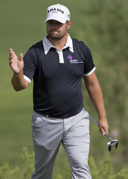 Ryan Moore reacts after sinking a putt for par on the third hole during the Justin Timberlake Shriners Hospitals for Children Open golf tournament on Thursday, Oct. 4, 2012, in Las Vegas. Moore finished 10 under for the first round. (AP Photo/Julie Jacobson)