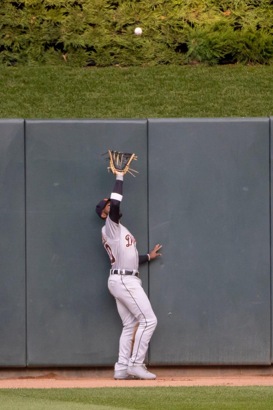 Detroit Tigers center fielder Akil Baddoo (60) catches a fly ball in the first inning at Target Field in Minneapolis on Friday, July 9, 2021.