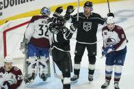 Los Angeles Kings right wing Adrian Kempe, second from right, celebrates with center Anze Kopitar (11) after scoring a goal during the third period of the team's NHL hockey game against the Colorado Avalanche on Thursday, Jan. 21, 2021, in Los Angeles. (AP Photo/Ashley Landis)