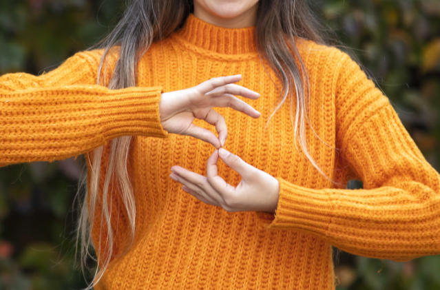 Sign language helps people who have trouble hearing to communicate. (Getty Images)