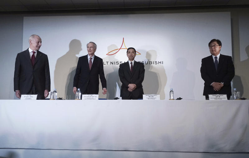 From left, Renault CEO Thierry Bollore, Renault Chairman Jean-Dominique Senard, Nissan CEO Hiroto Saikawa and Mitsubishi Motors Chairman and CEO Osamu Masuko arrive for a joint press conference following a board meeting at the Nissan headquarters in Yokohama, near Tokyo, Tuesday, March 12, 2019. (AP Photo/Eugene Hoshiko)