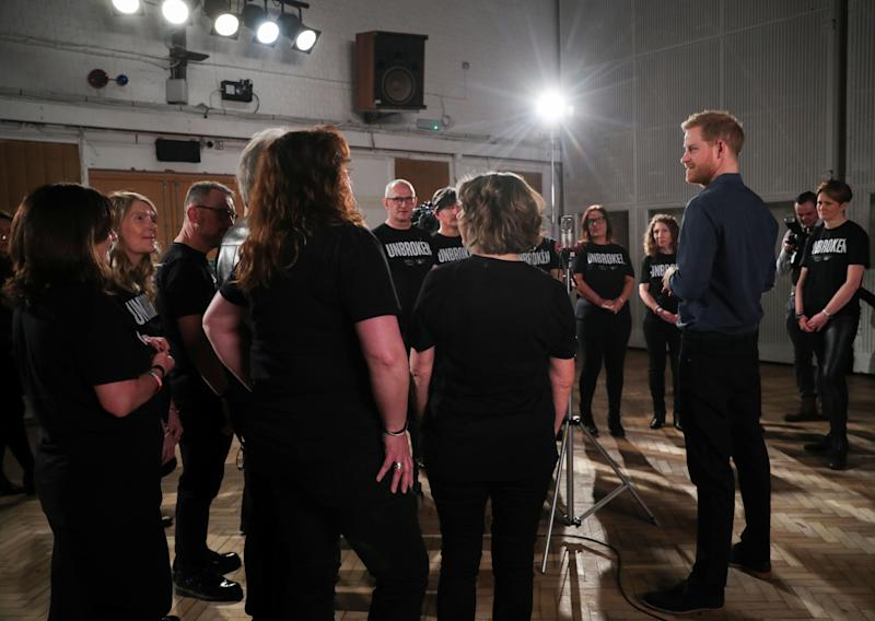 Britain's Prince Harry, Duke of Sussex chats with members of the Invictus Games Choir during his meeting with US singer Jon Bon Jovi at Abbey Road Studios in London on February 28, 2020