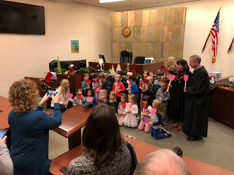 A photo of Michael's classmates with the judges on adoption day in Kent County, Michigan.