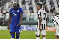 Chelsea's Romelu Lukaku, left, reacts after missing a scoring chance during the Champions League group H soccer match between Juventus and Chelsea at the Allianz stadium in Turin, Italy, Wednesday, Sept. 29, 2021. (AP Photo/Antonio Calanni)