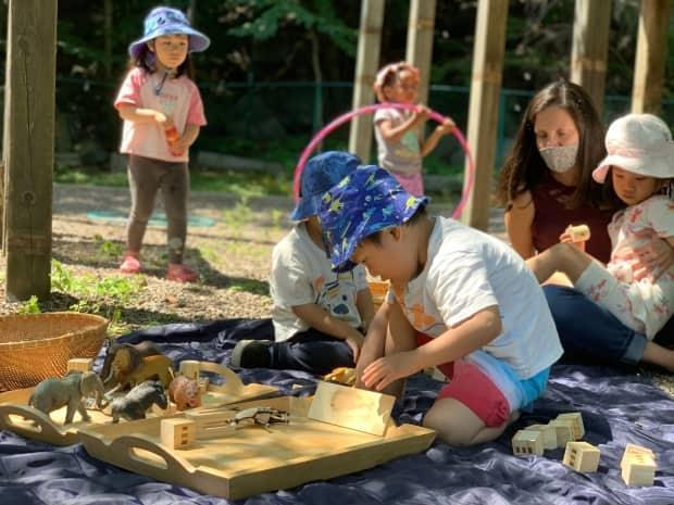 Children play at a child-care centre at Mount Saint Vincent University in Halifax on Tuesday, July 13, 2021, the day a $605-million affordable child-care agreement was announced. (Michael Gorman/CBC - image credit)