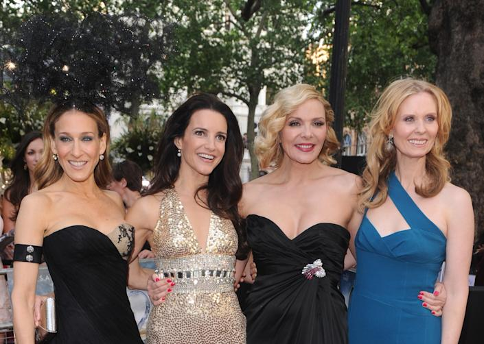 """(L to R): Sarah Jessica Parker, Kristen Davis, Kim Cattrall and Cynthia Nixon starred in the beloved franchise """"Sex and The City."""" (Photo: Rune Hellestad/Corbis via Getty Images)"""