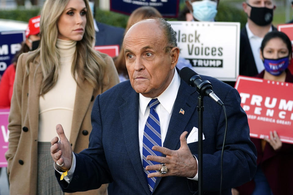 Rudy Giuliani, a lawyer for President Donald Trump, speaks during a news conference on legal challenges to vote counting in Pennsylvania, Wednesday, Nov. 4, 2020, in Philadelphia. At left is Lara Trump, daughter-in-law of President Trump. (AP Photo/Matt Slocum)