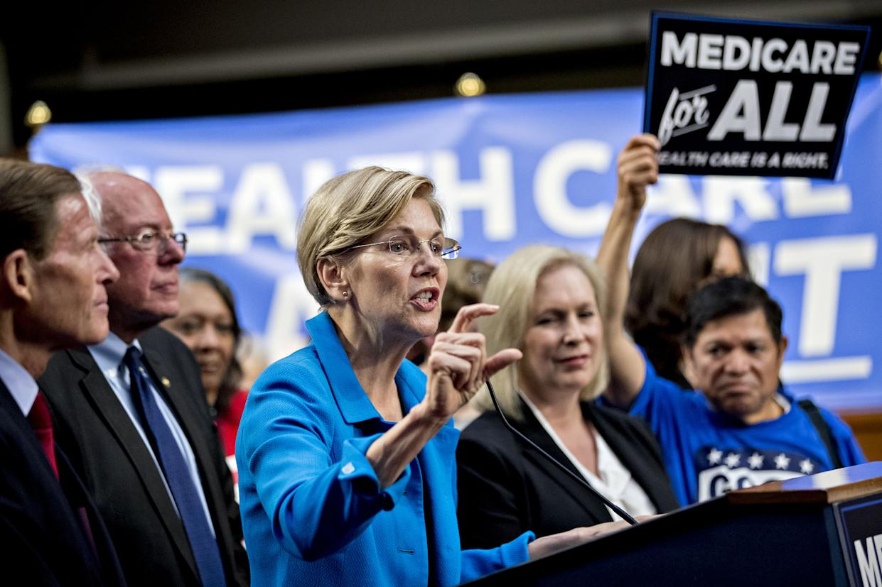 Senator Elizabeth Warren, a Democrat from Massachusetts, center, speaks during a health care bill news conference on Capitol Hill in Washington in 2017. (Photo: Andrew Harrer/Bloomberg via Getty Images)