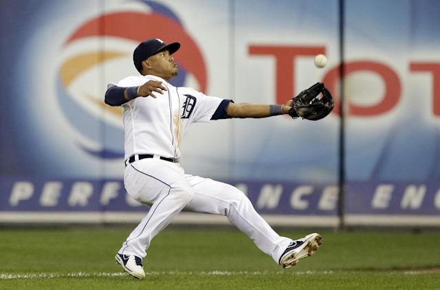 Detroit Tigers' Ramon Santiago catches a pop up in foul territory by Washington Nationals' Wilson Ramos during the seventh inning of a baseball game in Detroit, Tuesday, July 30, 2013. (AP Photo/Carlos Osorio)