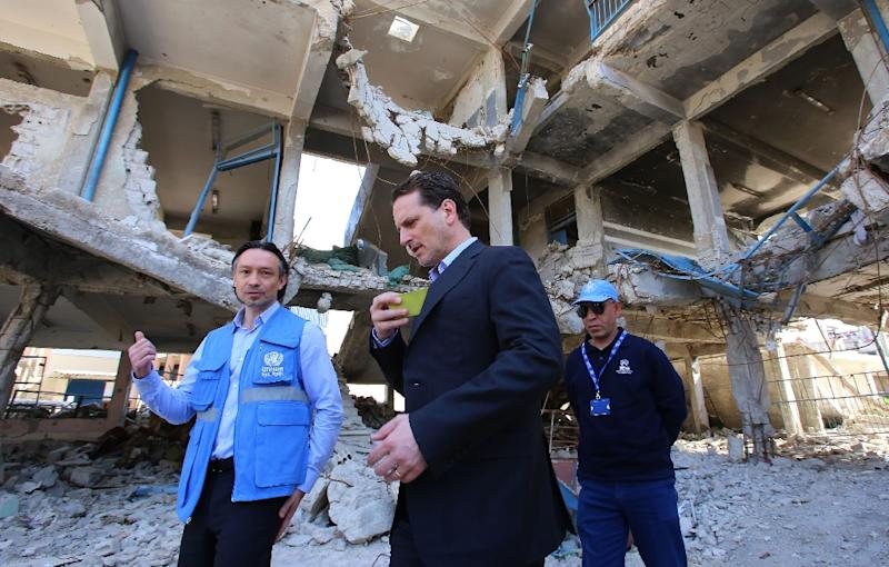 Pierre Krahenbuhl (C), Commissioner-General for the for the United Nations Relief and Works Agency for Palestine Refugees in the Near East (UNRWA) visits a damaged UNRWA school in Sit-Zeinab, a southern suburb of Damascus, on March 10, 2015