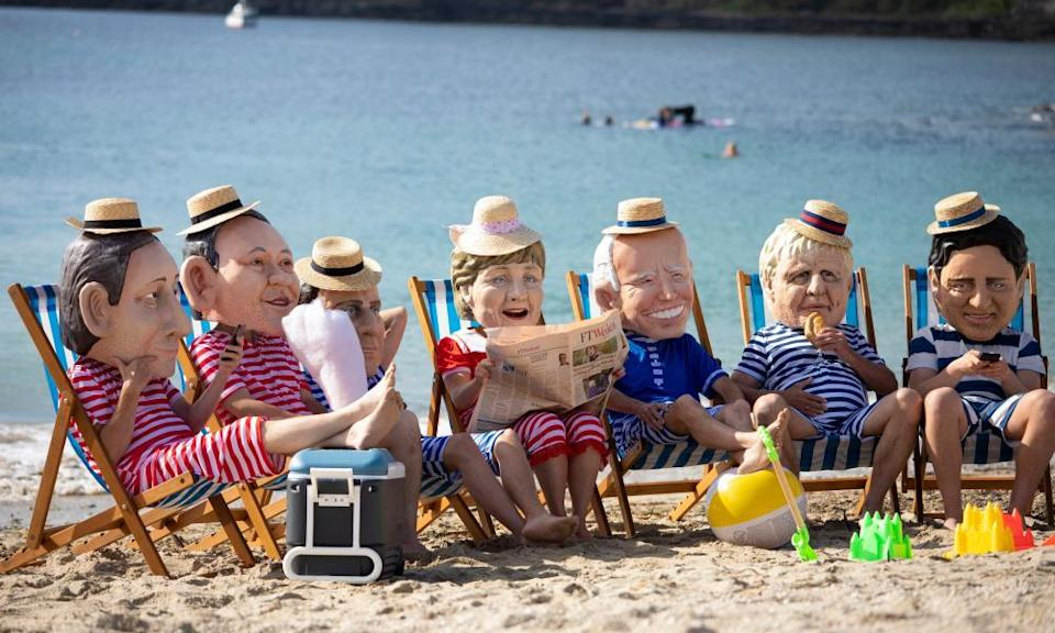 Oxfam campaigners posed as G7 leaders on Swanpool Beach.
