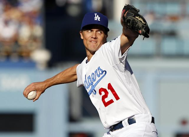 Los Angeles Dodgers starting pitcher Zack Greinke throws to a San Francisco Giants batter in the first inning of a baseball game Sunday, April 6, 2014, in Los Angeles. (AP Photo/Alex Gallardo)