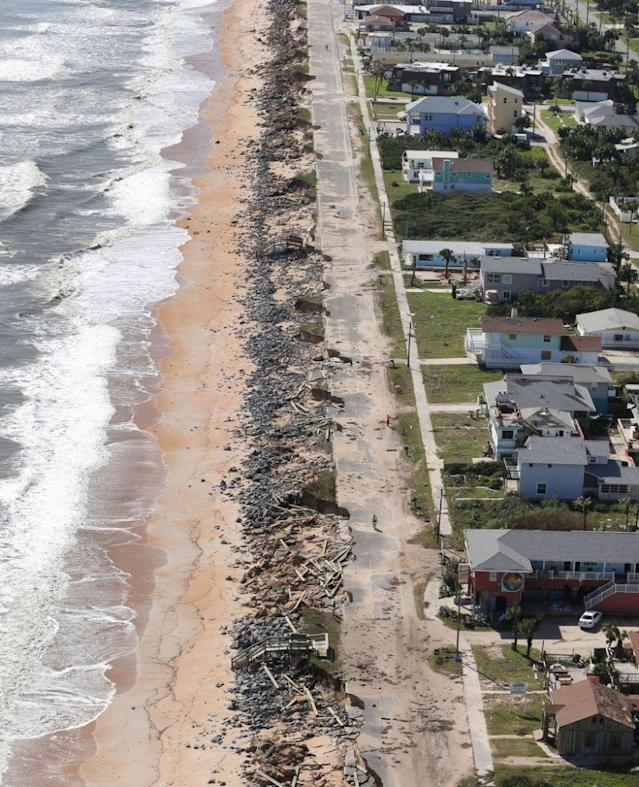 <p>Debris lies on a portion of the damaged A1A Highway which was closed in Flagler Beach, Fla., on Saturday, Oct. 8, 2016, after pounding surf from Hurricane Matthew which brushed Florida's east coast. (Photo: Red Huber/Orlando Sentinel via AP) </p>