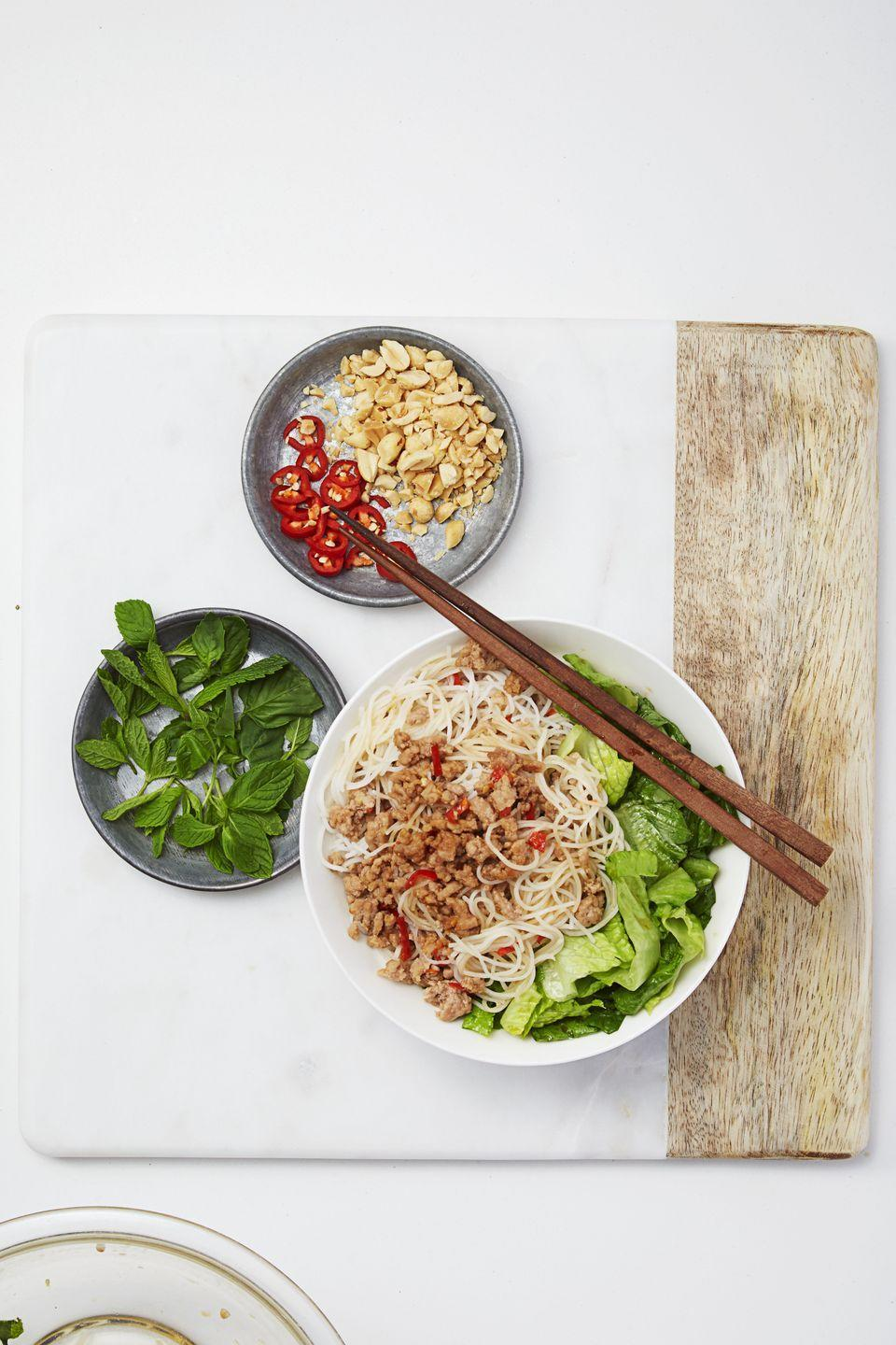 """<p>The secret to this filling, flavorful salad? Thin rice noodles (a.k.a. <a href=""""https://www.goodhousekeeping.com/food-recipes/cooking/tips/a17291/noodling-around-1101/"""" rel=""""nofollow noopener"""" target=""""_blank"""" data-ylk=""""slk:vermicelli"""" class=""""link rapid-noclick-resp"""">vermicelli</a>) that cook quickly and absorb sauce easily.</p><p><a href=""""https://www.goodhousekeeping.com/food-recipes/a32684/vietnamese-noodle-salad/ """" rel=""""nofollow noopener"""" target=""""_blank"""" data-ylk=""""slk:Get the recipe for Vietnamese Noodle Salad »"""" class=""""link rapid-noclick-resp""""><em>Get the recipe for Vietnamese Noodle Salad »</em></a> </p>"""