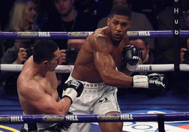 Anthony Joshua goes on the offensive against Joseph Parker (AFP Photo/Oli SCARFF )