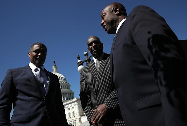 Rep. Cedric Richmond (D-LA), Baseball Hall of Famer Andre Dawson and Sen. Tim Scott (R-SC) gathered on Capitol Hill to announce the  <span>Integration of Baseball Commemorative Coin Act.</span> (Photo by Win McNamee/Getty Images)