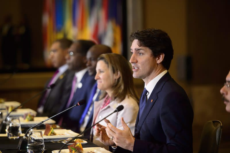 <p>Prime Minister Justin Trudeau is joined by Foreign Affairs Minister Chrystia Freeland as they host a Caribbean Leaders Working Luncheon while in Lima. Photo from The Canadian Press. </p>