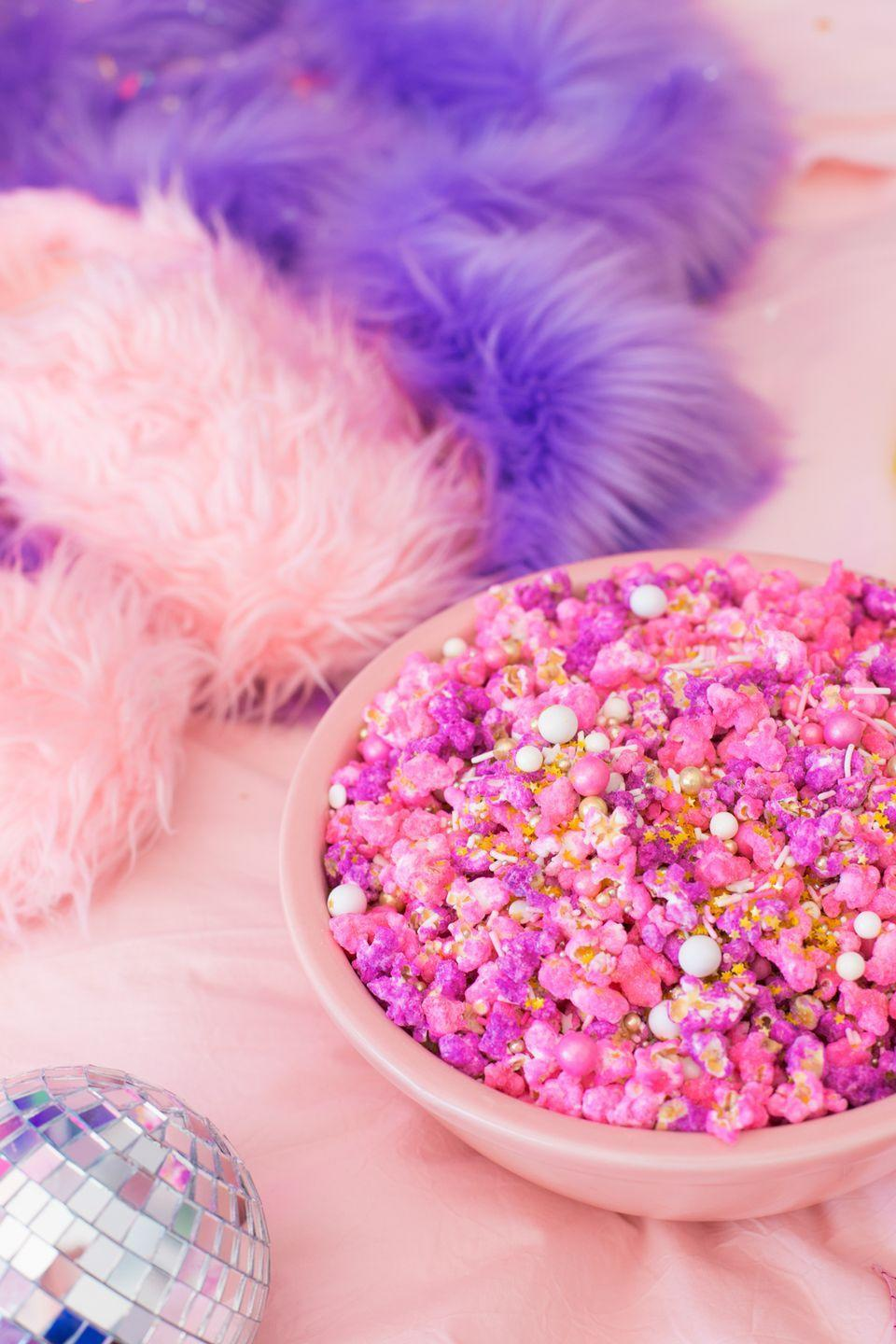 "<p>Throw it back even further to your teen years in the '80s with a <em>Pretty in Pink</em> party. This classic flick will have you and your guests feeling nostalgic in no time. Plus, there are plenty of fun ways to incorporate pink foods. </p><p><strong>Get the recipe from <a href=""https://studiodiy.com/pretty-pink-pastel-candied-popcorn/"" rel=""nofollow noopener"" target=""_blank"" data-ylk=""slk:Studio DIY!"" class=""link rapid-noclick-resp"">Studio DIY!</a>.</strong></p><p><a class=""link rapid-noclick-resp"" href=""https://go.redirectingat.com?id=74968X1596630&url=https%3A%2F%2Fwww.walmart.com%2Fip%2FSTARBURST-All-Pink-Fruit-Chews-Candy-50-Ounce-Party-Size-Resealable-Bag%2F521090764&sref=https%3A%2F%2Fwww.thepioneerwoman.com%2Fhome-lifestyle%2Fentertaining%2Fg34192298%2F50th-birthday-party-ideas%2F"" rel=""nofollow noopener"" target=""_blank"" data-ylk=""slk:SHOP ALL-PINK STARBURSTS"">SHOP ALL-PINK STARBURSTS</a></p>"