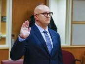 William Braddock raises his hand to take an oath during a hearing Tuesday, June 22, 2021, in Clearwater, Fla. Anna Paulina Luna, who plans to run for Florida's District 13 seat after losing a race for the slot in 2020 to Democratic U.S. Rep. Charlie Crist, contends in court documents that GOP challenger William Braddock is stalking her and wants her dead. Luna has filed a petition for a permanent restraining order. Braddock denies the claims and wants to see any evidence against him. (Chris Urso/Tampa Bay Times via AP)
