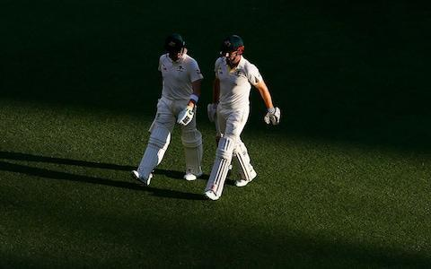 <span>A solid evening's work:Australia's Shaun Marsh and Steve Smith walk off at the end of play during day two</span> <span>Credit: PA </span>