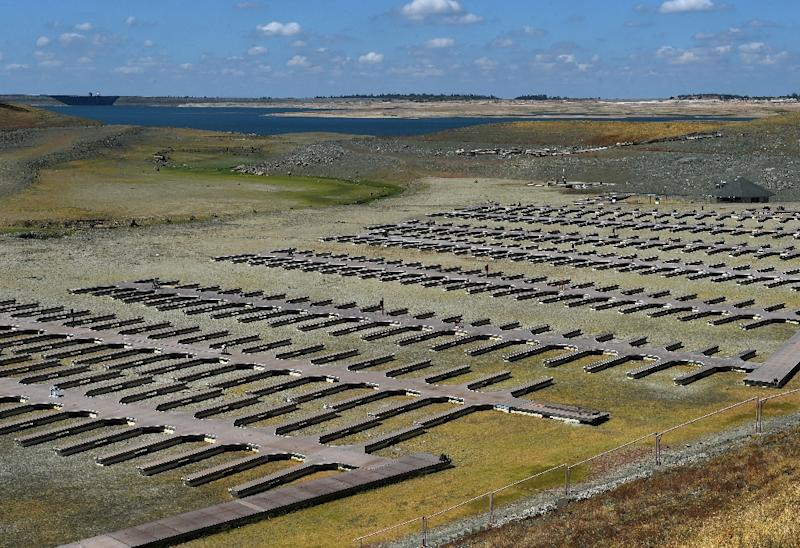 Boat docks sit empty on dry land, as Folsom Lake reservoir near Sacramento stands at only 18 percent capacity, as the severe drought continues in California on September 17, 2015 (AFP Photo/Mark Ralston)