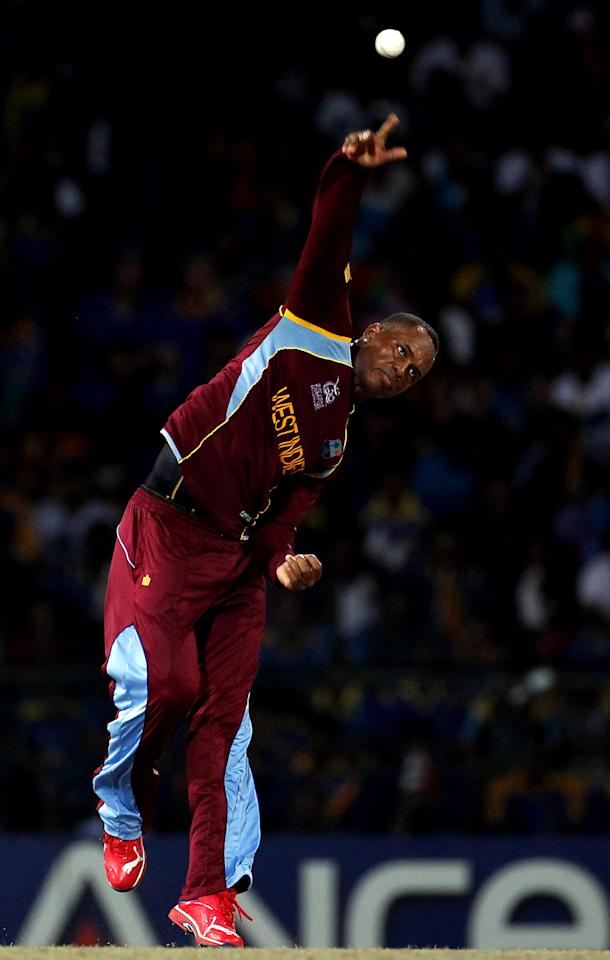 COLOMBO ,SRI LANKA - OCTOBER 7:  Marlon Samuels of West Indies bowls during the ICC  World Twenty20 2012 Final between Sri Lanka and West Indies at R. Premadasa Stadium on October 7, 2012 in Colombo, Sri Lanka.(Photo by Graham Crouch-ICC/ICC via Getty Images)