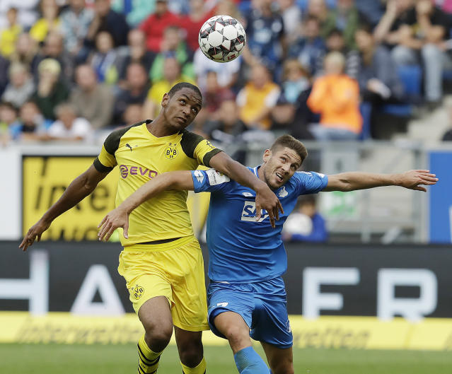 Hoffenheim's Andrej Kramaric, right, and Dortmund's Abdou Diall, left, challenge for the ball during the German Bundesliga soccer match between TSG 1899 Hoffenheim and Borussia Dortmund in Sinsheim, Germany, Saturday, Sept. 22, 2018. (AP Photo/Michael Probst)