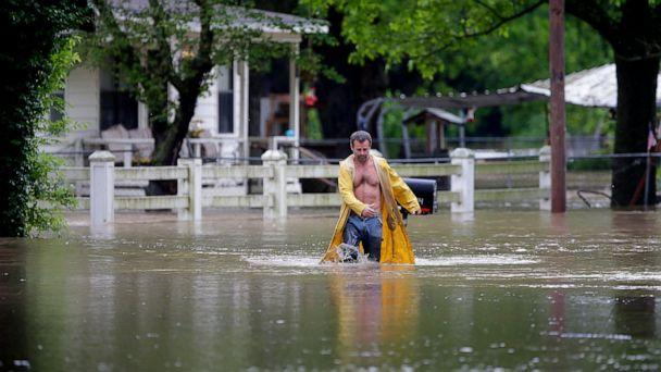 PHOTO: David Dick wades out of the water after checking on his flooded home in Sperry, Okla., Tuesday, May 21, 2019. (Mike Simons/Tulsa World via AP)