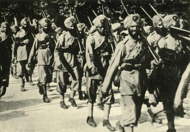 "Indian soldiers in France, First World War, 1914, (circa 1920). A Sikh regiment on the march. Over one million Indian troops in the British Indian Army (of the Raj) fought in the European, Mediterranean and the Middle East theatres of war. At least 74,187 Indian soldiers died, with 67,000 wounded. From ""The Great World War - A History"" Volume I, edited by Frank A Mumby. [The Gresham Publishing Company Ltd, London, circa 1920]. Artist Unknown. (Photo by The Print Collector via Getty Images)"