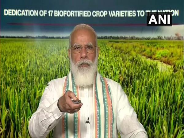 The Prime Minister dedicated to the nation 17 recently developed biofortified varieties of eight crops. [Photo/ANI]
