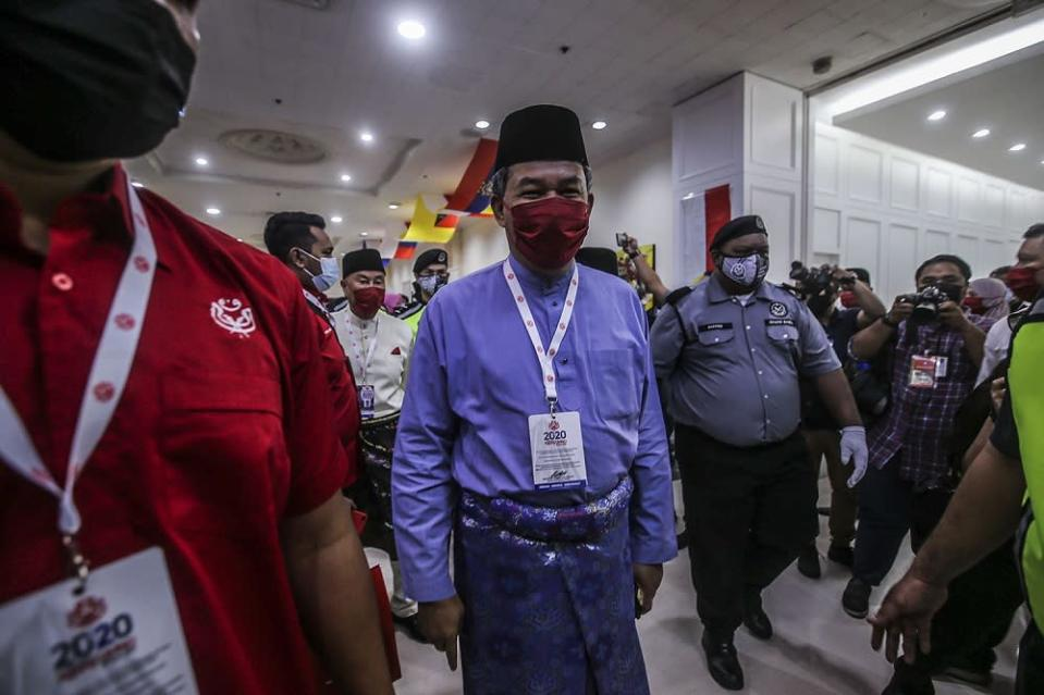 Umno deputy president Datuk Seri Mohamad Hasan arrives at the 2020 Umno annual general meeting in Kuala Lumpur March 27, 2021. Mohamad stressed that any decision made by the government, especially on matters of public spending must be done through the right values and principles. ― Picture by Hari Anggara