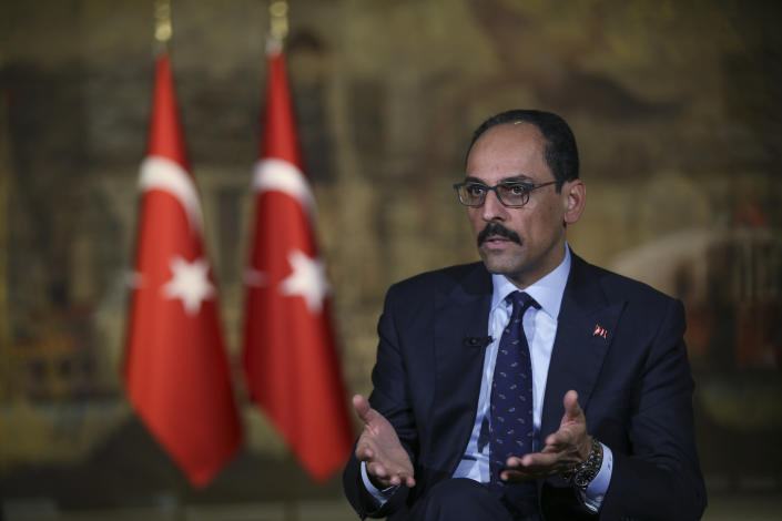 Ibrahim Kalin, chief advisor to Turkey's President Recep Tayyip Erdogan, speaks during an interview in Istanbul, Saturday, Oct. 19, 2019. Erdogan wants Syrian government forces to move out of areas near the Turkish border so it can resettle up to 2 million refugees there, Kalin said, adding that Erdogan will raise the issue in talks next week with Syria's ally, Russian President Vladimir Putin. Government troops have moved in to several locations in northeastern Syria this week, invited by Kurdish-led fighters to protect them from Turkey's invasion. (AP Photo/Emrah Gurel)