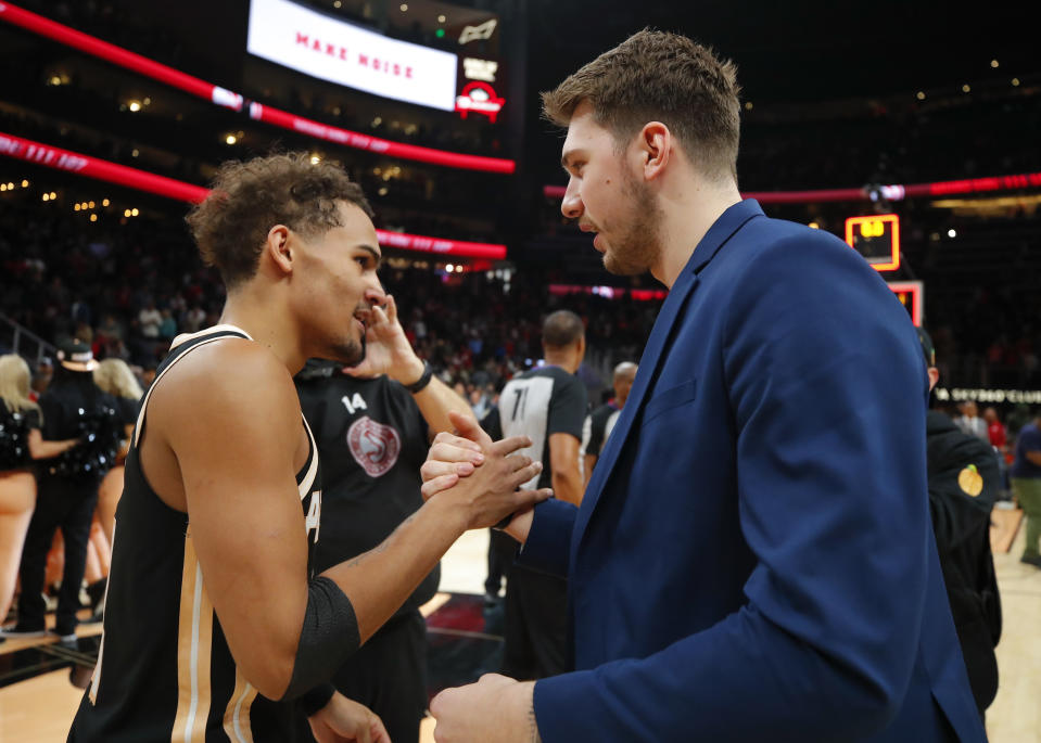 Trae Young and Luka Doncic will forever be linked by the 2018 NBA draft. (Todd Kirkland/Getty Images)