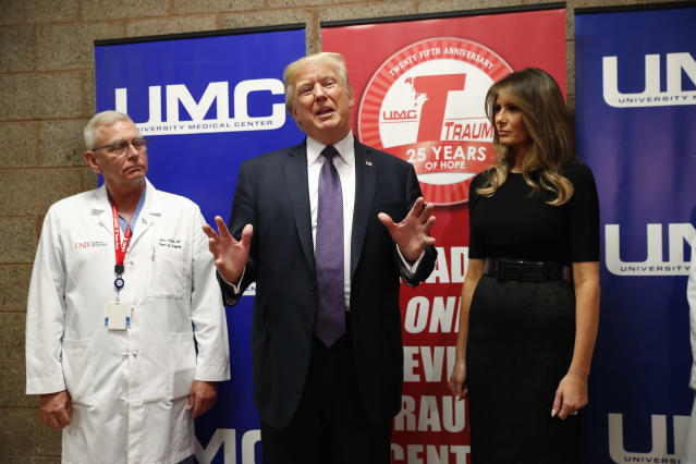 <p>President Donald Trump speaks with reporters with first lady Melania Trump and UNLV Trauma Center Medical Director John Fildes after meeting with patients in the wake of the mass shooting in Las Vegas, Nev., Oct. 4, 2017. (Photo: Kevin Lamarque/Reuters) </p>