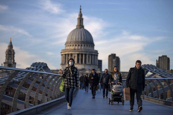 PHOTO: People cross the millennium bridge in front of St. Pauls Cathedral, March 16, 2020, in London, England. (Justin Setterfield/Getty Images)