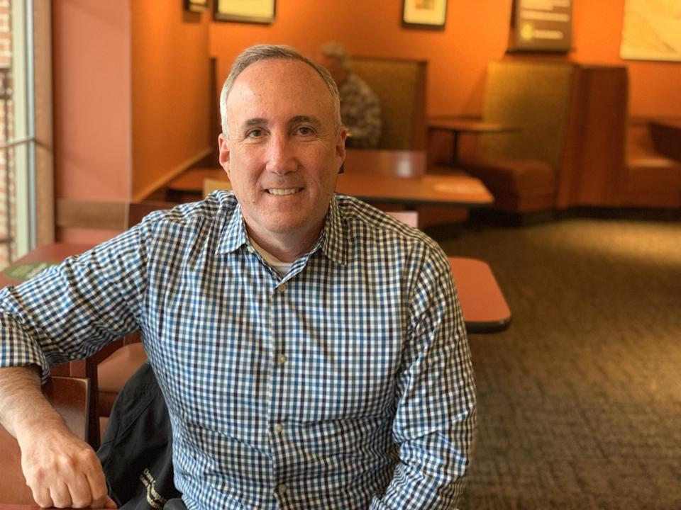 Ohio state Rep. Dave Greenspan, a Republican representing a suburban district, sits in a restaurant.