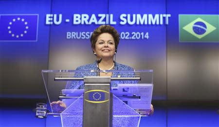 Brazil's President Dilma Rousseff speaks at a joint news conference with European Council President Herman Van Rompuy and EU Commission President Jose Manuel Barroso (unseen) during an EU-Brazil summit in Brussels February 24, 2014. REUTERS/Francois Lenoir