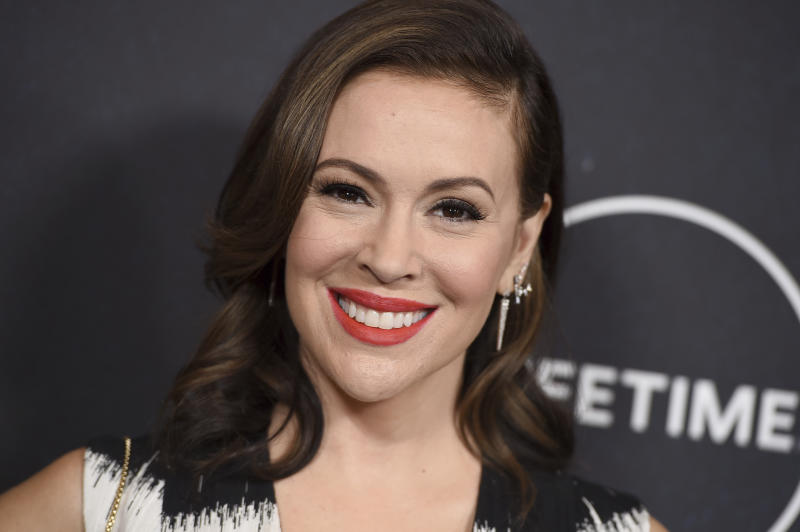 FILE - In this Oct. 12, 2018, file photo, Alyssa Milano arrives at Variety's Power of Women event at the Beverly Wilshire hotel in Beverly Hills, Calif. On Oct. 15, 2017, Milano urged the Twittersphere to join her in sharing a personal story of sexual harassment in the wake of rape allegations against Harvey Weinstein. The response was immediate and overwhelming, and touched off a cultural movement that has shed light on the pervasiveness of sexual harassment, assault and violence against women across all industries, building on work started over a decade earlier by activist Tarana Burke. (Photo by Jordan Strauss/Invision/AP, File)