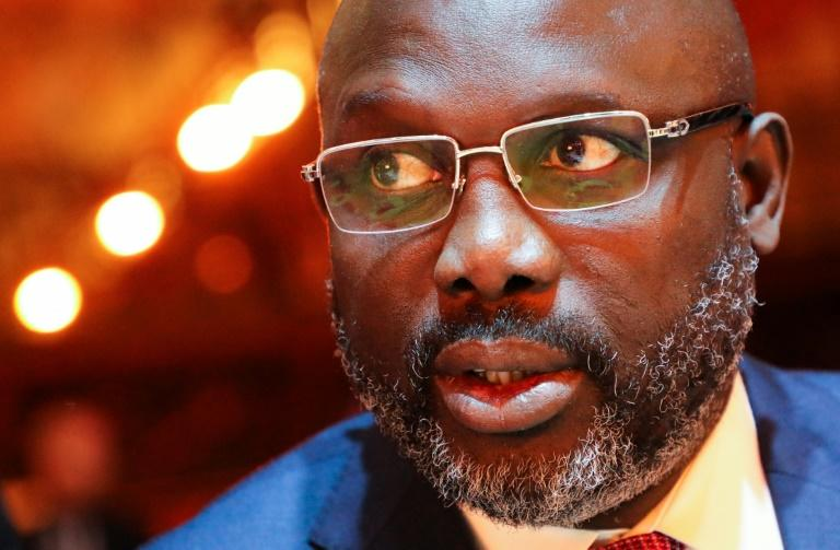 Rampant inflation has left many people in Liberia struggling and increasingly turning their anger on President George Weah (AFP Photo/ludovic MARIN)