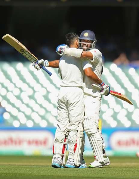 ADELAIDE, AUSTRALIA - DECEMBER 13: Virat Kohli of India is congratulated by Murali Vijay of India after reaching his century during day five of the First Test match between Australia and India at the Adelaide Oval on December 13, 2014 in Adelaide, Australia. (Photo by Scott Barbour/Getty Images)
