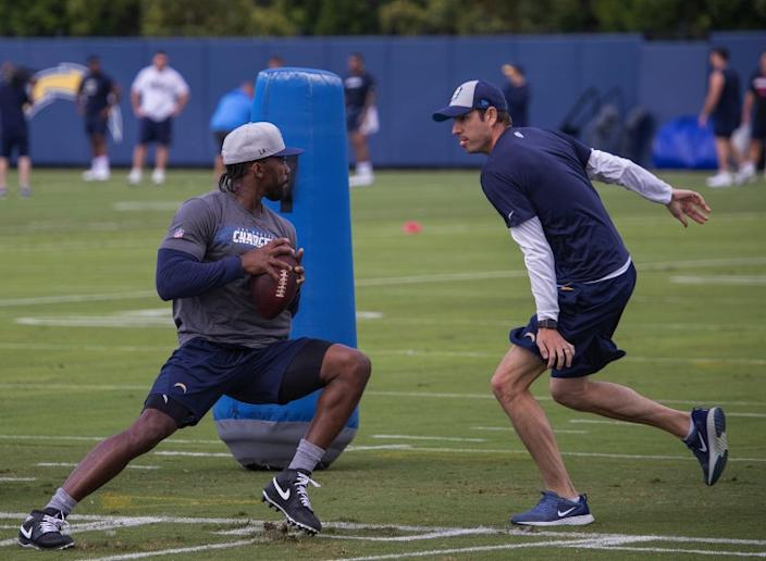 "Tyrod Taylor goes through a drill at training camp last summer. Can he carry the Chargers for a whole season? <span class=""copyright"">(Allen J. Schaben/Los Angeles Times)</span>"