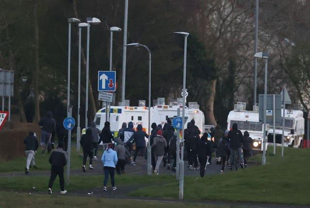 Youths gather near PSNI vehicles in Shantallow