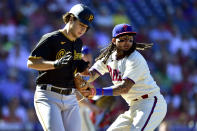 Philadelphia Phillies' Freddy Galvis, right, tags out Pittsburgh Pirates' Max Kranick (45) during the fourth inning of a baseball game, Sunday, Sept. 26, 2021, in Philadelphia. (AP Photo/Derik Hamilton)