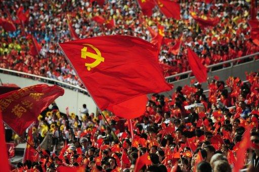 Chinese wave flags of the Communist Party of China as they celebrate the 90th anniversary of the party's founding, in Chongqing in 2011. A Chinese official sentenced without trial to hard labour for opposing the Maoist revival policies of disgraced politician Bo Xilai has been freed and is seeking compensation, his lawyer said Tuesday
