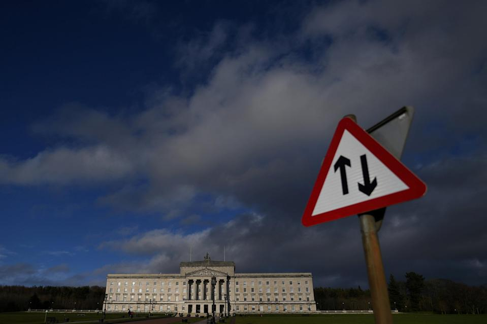 A road sign is seen in front of Parliament Buildings at Stormont in Belfast, Northern Ireland. Photo: Reuters