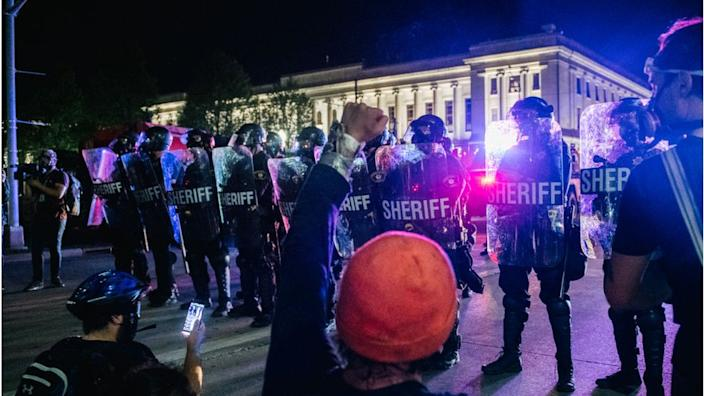 Police and protesters in Kenosha