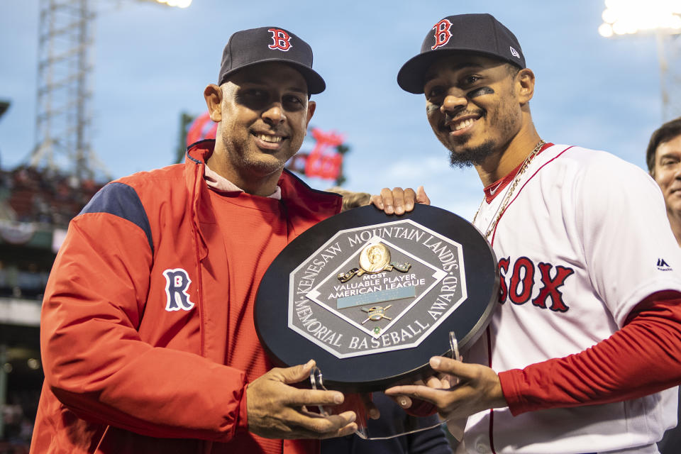 Mookie Betts, right, receives his 2018 MVP plaque, which is inscribed as the Kenesaw Mountain Landis Memorial Baseball Award. (Photo by Billie Weiss/Boston Red Sox/Getty Images)