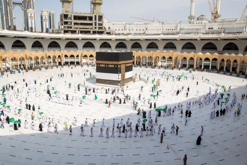 Pilgrims keeping social distance perform their Umrah in the Grand Mosque during the annual Haj pilgrimage, in the holy city of Mecca