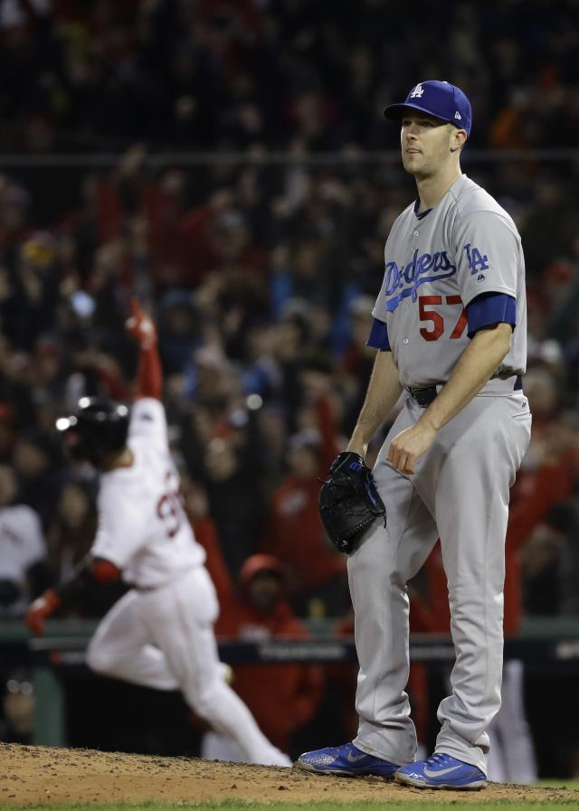 Boston Red Sox's Eduardo Nunez reacts after hitting a three-run home run off Los Angeles Dodgers relief pitcher Alex Wood during the seventh inning of Game 1 of the World Series baseball game Tuesday, Oct. 23, 2018, in Boston. (AP Photo/Matt Slocum)
